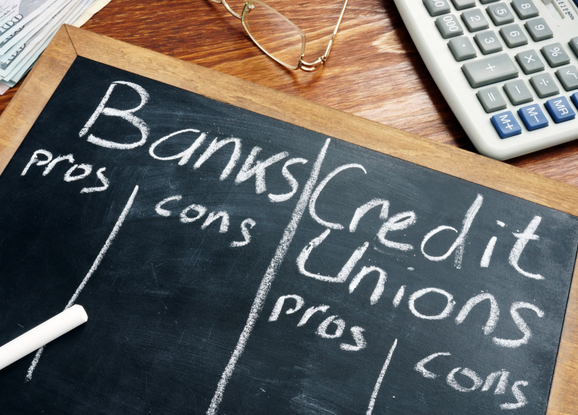 chalkboard with pros and cons of banks and credit unions